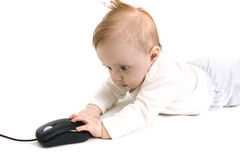 Baby with computer mouse Stock Images