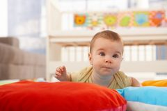 Baby concentrating on crawling royalty free stock image