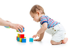 Baby with construction set over white background Stock Photo