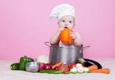 Baby cook. With vegetables in studio Stock Photography