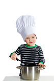 Baby cook. Smiling little baby boy in cook hat duging cooking - isolated on white background Stock Images