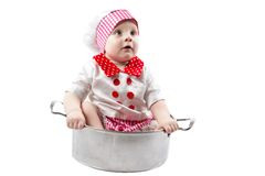 Baby cook boy wearing chef hat with fresh vegetables and fruits. Use it for a child, healthy food concept Royalty Free Stock Photo