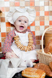 Baby cook with bread Stock Photography