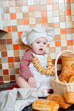 Baby cook with bread Stock Photo
