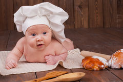 The baby cook flour buns bread. The baby in the head cook flour buns bread Stock Photo