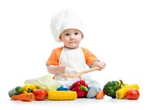 Baby cook with fresh vegetables Stock Photo