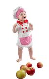 Baby cook girl wearing chef hat with fresh vegetables and fruits. Royalty Free Stock Photography
