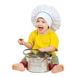 Baby cook  with  pan. Isolated over white. Baby cook in toque with  pan. Isolated over white background Stock Photography