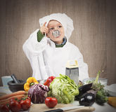 Baby cook tastes Royalty Free Stock Image