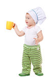 Baby cook in toque with cup Royalty Free Stock Photo