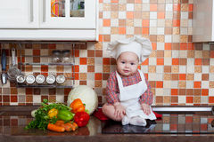 Baby cook with vegetables Stock Photography