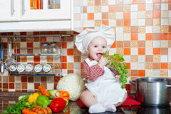 Baby cook with vegetables Stock Image