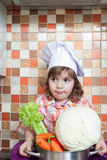 Baby cook with vegetables Royalty Free Stock Photos