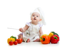 Baby cook with vegetables Stock Photo