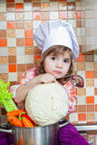 Baby cook with vegetables Royalty Free Stock Image