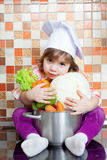 Baby cook with vegetables Stock Images