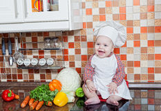Baby cook with vegetables Royalty Free Stock Photography