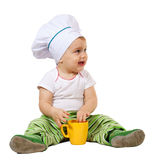 Baby cook white background. Baby cook in toque with cup over white background Royalty Free Stock Photos