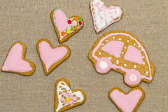 Baby cookie on burlap in a heart shape Royalty Free Stock Images