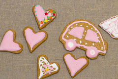 Baby cookie on burlap in a heart shape Stock Image