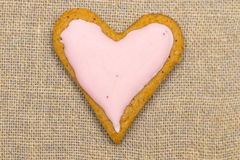 Baby cookie on burlap in a heart shape Royalty Free Stock Image