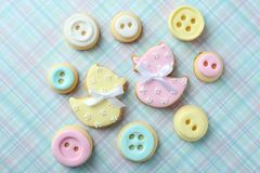 Baby cookies decorated with glaze. On color background royalty free stock photography
