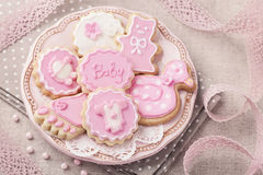 Baby cookies. On a pink plate royalty free stock photos