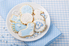 Baby cookies. On a white plate stock image