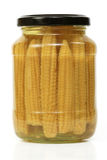 Baby Corn. Yellow ears of baby corn preserved in a glass jar Stock Photos