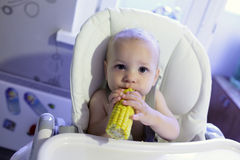 Baby with corn Stock Photo
