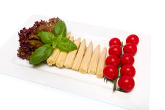 Baby corn. And cherry tomatoes with basil Royalty Free Stock Photos