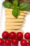 Baby corn. And cherry tomatoes with basil Stock Photos