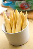Baby corn cobs. On kitchen table Royalty Free Stock Images