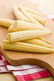Baby corn cobs. On kitchen table Royalty Free Stock Photos