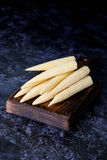Baby corn cobs. Close up, vertical Stock Image