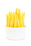 Baby corn in a cup isolated on white background Stock Image