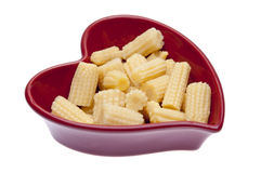 Baby Corn in a Heart Shaped Dish Royalty Free Stock Images