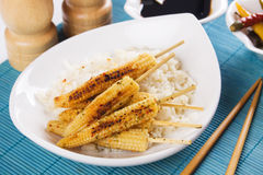 Baby corn on skewer. Grilled baby corn on skewer with cooked rice, tasty vegetarian meal Stock Images