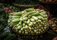 Baby corn stacked on top of bamboo webbing in the middle various kind of vegetables photo taken in Bogor traditional Stock Photos