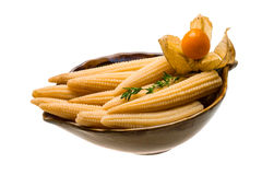 Baby corn. With thyme isolated on white background Stock Photos