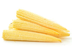 Baby corn on a white background Stock Photo