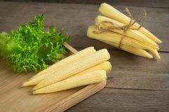 Baby corns on cutting board. Royalty Free Stock Image