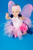 Baby in costume fairies on the blue background Royalty Free Stock Photos