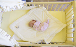 Baby in cot Stock Photo