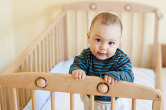 Baby in cot Royalty Free Stock Image