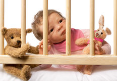 Baby in Cot Stock Photos