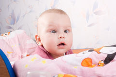 Baby in the cot Stock Images