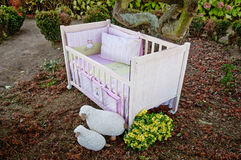 Baby cot bed in garden Royalty Free Stock Image