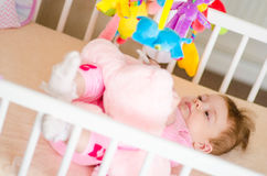 Baby in a cot Royalty Free Stock Images