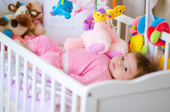 Baby in a cot Royalty Free Stock Image